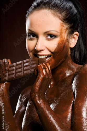 Portrait of woman covered sweet cream chocolate