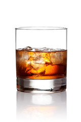 Glass of scotch whiskey and ice with clipping path