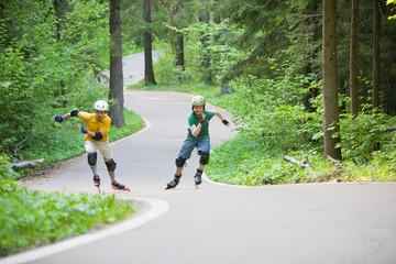 Two men rollerblading at park