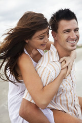 Man and Woman Couple Having Romantic Fun On Beach