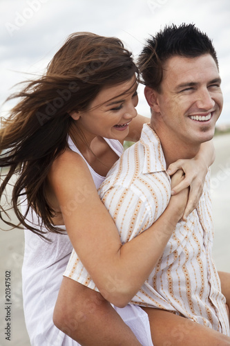 Man and Woman Couple Having Romantic Fun On Beach
