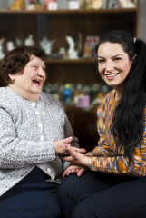 Grandmother and grandaughter having a funny conversation