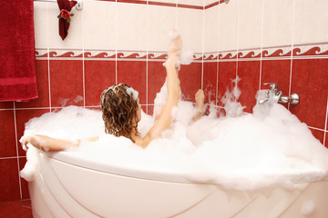 Young woman enjoys bath-foam