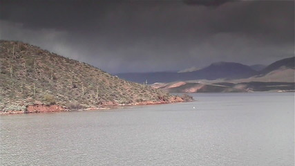 Storm approaching desert lake