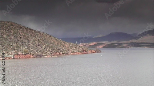 Storm approaching desert lake