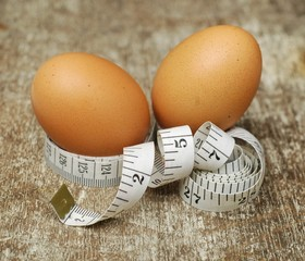 Chicken eggs on measuring tape