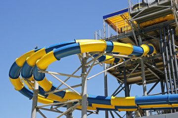 Hills in an aquapark against the dark blue sky