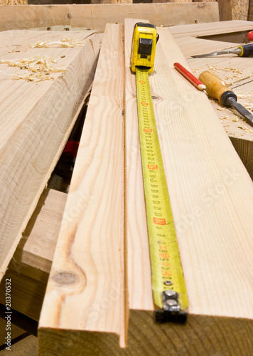 Carpentry tape-measure with tools