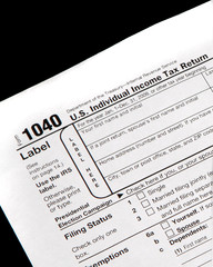 Tax forms on a black background - vertical