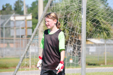 Soccer goalie on field