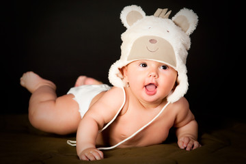 smiling baby in bear cap