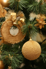 christmas tree closeup with gold decoration
