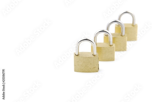 Golden closed padlocks on white