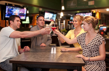 Cheerful friends toasting