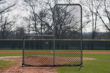 Pitching Screen in front of mound of baseball field