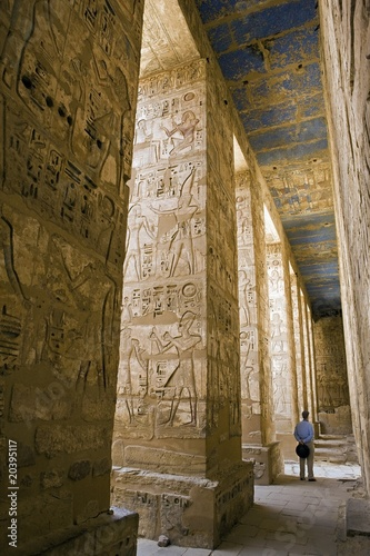 Painted carvings of hieroglyphs and figures at Medinet Habu, Mortuary Temple of Ramses III aka The Ramesseum.  West Bank, Luxor, Egypt
