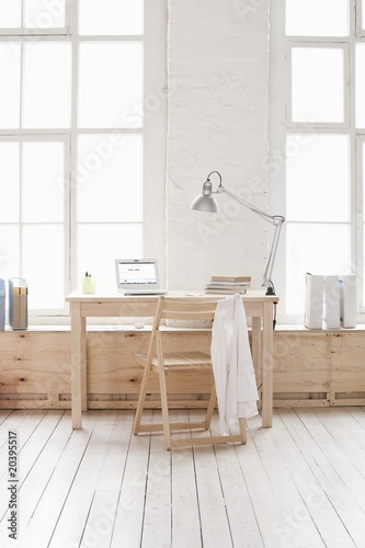 Desk in window area of loft apartment