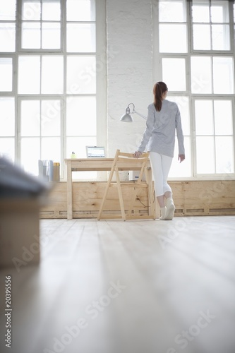 Woman walks across loft apartment