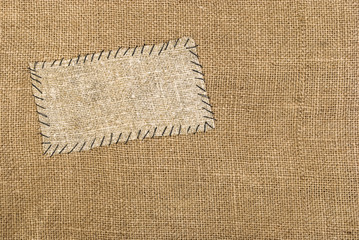 Sackcloth tag on sackcloth material