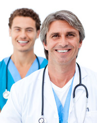 Cheerful male doctors smiling at the camera