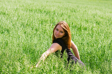 Happy young woman in a field.