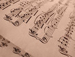 sepia toned old sheets of musical notes