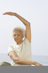 Senior woman sits in yoga pose