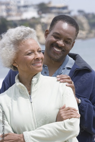 Senior woman with mature man on beach