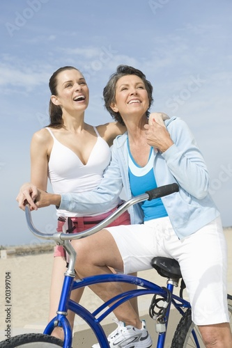 Mature and Mid adult woman with bicycle