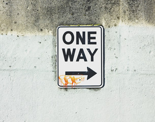 one way sign with tag