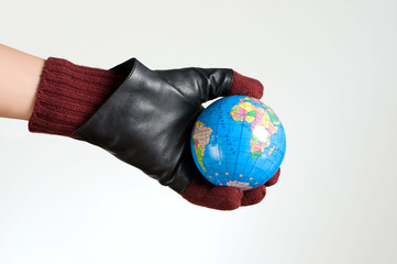Hands with glove holding a world map