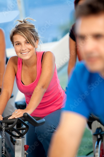 woman spinning at the gym