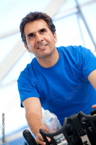 man spinning at the gym