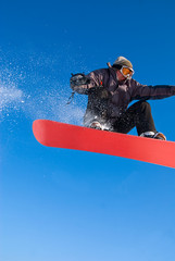 Snowboarder Jump In Air, Snow Flying
