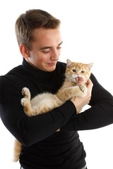 Young man with small kitten.