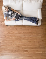 Overhead View of Woman on Couch With Laptop