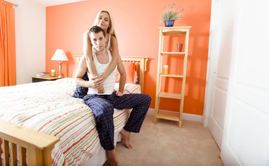 Couple Relaxing in Their Bedroom