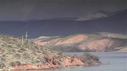Storm approaching a desert lake