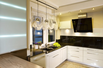Interior details of modern fitted kitchen in home.