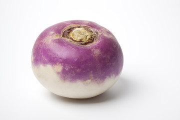 One whole single purple topped turnip on white background