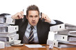 Stressed business man with telephones frustrated in office