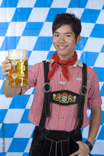 Smiling happy man holding Oktoberfest beer stein (Mass)