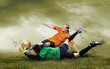 Outdoors: Shoot of football player and jump of goalkeeper