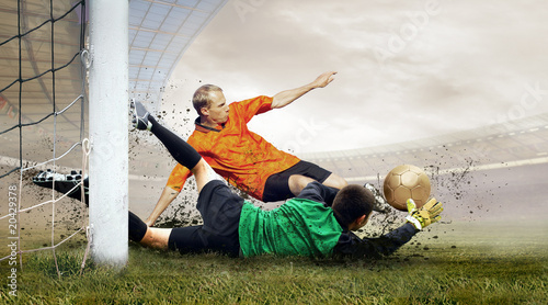 Foto op Plexiglas Luchtsport Shoot of football player and jump of goalkeeper on the field of