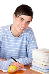 Young handsome male student learning at desk - Hausaufgaben