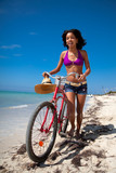 Beautiful caribbean woman with bicycle