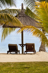 Chairs and parasol on tropical beach