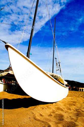 catamaran on the beach, close, wide angle, vertical