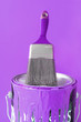 Purple paint and brush