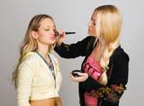 Professional beautician applying makeup poster
